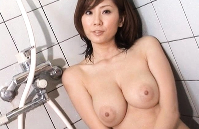 Yuma Asami Pretty Asian doll shows off her firm tits in the bathroom
