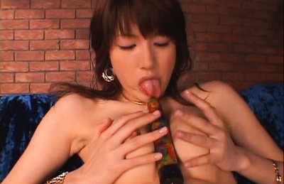 Erika Satoh Japanese doll fondles her juicy pussy