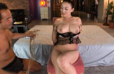 Mako Oda is tied up and and Japanese guys play with her cunt