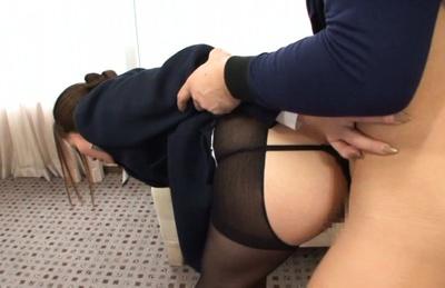 Stewardess Yuna Shiina enjoys cock sucking