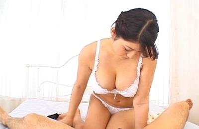 Megu Fujirua Asian model is fondling a cock before sucking it