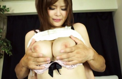 Busty Asian gal deepthroats two cocks and rides them hard