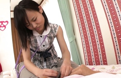Petite horny Japanese teen Erika Momotani exeriences a blowjob